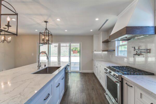 white-kitchen-brown-hardwood-floor-min
